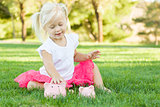 Little Girl Having Fun with Her Piggy Banks Outside