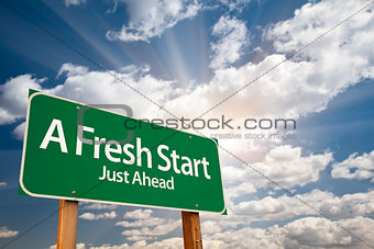 A Fresh Start Green Road Sign Over Clouds