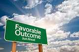 Favorable Outcome Green Road Sign Over Clouds