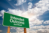 Intended Outcome Green Road Sign Over Clouds