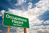Occupational Hazard Green Road Sign Over Clouds