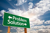 Problem and Solution Green Road Sign Over Clouds