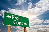 Pros and Cons Green Road Sign Over Clouds