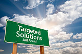 Targeted Solutions Green Road Sign Over Clouds