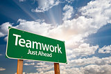 Teamwork Green Road Sign Over Clouds