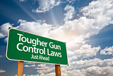 Tougher Gun Control Laws Green Road Sign Over Clouds