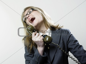 Woman laughing at telephone