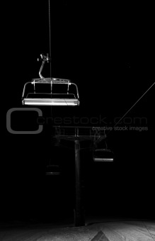 Chairlifts disappearing in the night