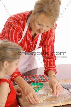 beautiful woman and child baking cookies isolated on white