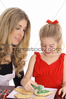 beautiful mother and daughter with cookies isolated on white