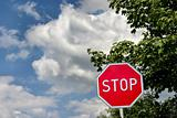 stop sign against cloudy sky