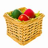 Multi-coloured eggs in a basket