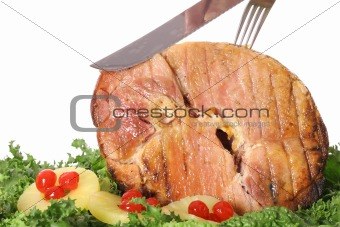 carving a gorgeous ham isolated on white