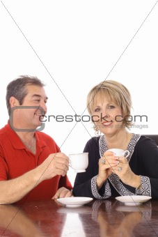 attractive couple having coffee isolated on white