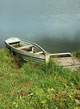Old wooden boat at a berth