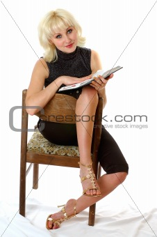 blondie reading on a chair