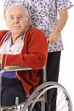 shot of a handsome elderly man in wheelchair with nurse