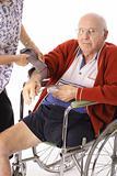 shot of checking senior citizens blood pressure