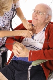 shot of a happy elderly man in wheelchair checking vitals