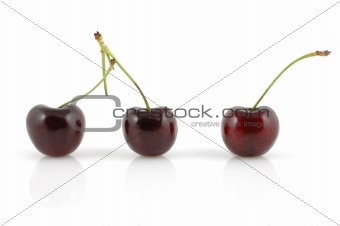Three cherries with reflection