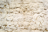 Background of old cracked painted brick wall with cement
