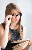 Teenage girl in glasses with  books