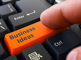 Business Ideas - Clicking Orange Keyboard Button.