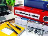Talent Management on Red Ring Binder. Blurred, Toned Image.