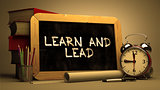 Learn and Lead Concept Hand Drawn on Chalkboard.