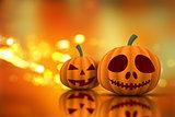 3D Halloween pumpkins on a bokeh lights background