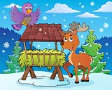 Hay rack with reindeer and bird