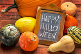 Happy Halloween on blackboard with squash