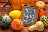 Happy Halloween on blackboard with squash