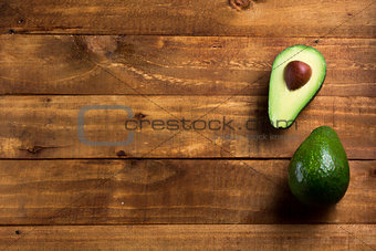 Background fresh avocado on the dark wooden table