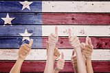 Composite image of hands up and thumbs raised