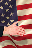 Composite image of hand of businessman offering handshake