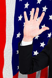 Composite image of businessman in suit with hand raised
