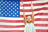 Composite image of cute girl with american flag