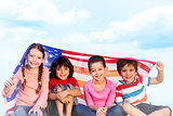 Composite image of children with american flag