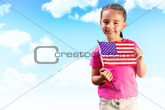 Composite image of little girl with american flag