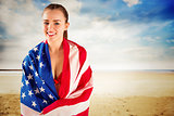 Composite image of pretty girl in bikini with american flag