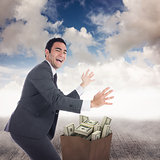Composite image of excited businessman catching