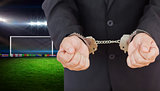 Composite image of handcuffed businessman