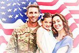 Composite image of soldier reunited with family