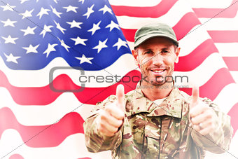 Composite image of soldier showing thumbs up