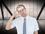 Composite image of geeky businessman thinking with finger on temple