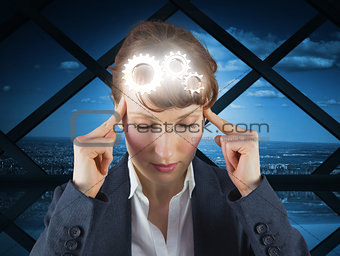 Composite image of stressed businesswoman