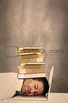 Composite image of tired businessman resting on laptop