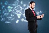 Composite image of businessman scrolling on his digital tablet