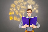 Composite image of geeky businessman reading a book